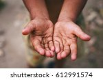 Small photo of Hands of a homeless child,begging palm, begging hand, Hungey man.