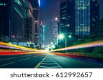 the traffic light trails of city | Shutterstock . vector #612992657