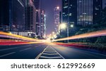 the traffic light trails of city | Shutterstock . vector #612992669