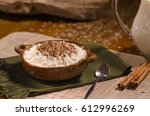 rice pudding in a clay bowl.... | Shutterstock . vector #612996269