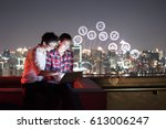 a man and woman using laptop... | Shutterstock . vector #613006247