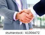 handshake isolated on white... | Shutterstock . vector #61306672