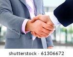handshake isolated on white... | Shutterstock . vector #61306672