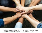 group of people united hands to