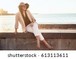 young stylish woman wearing... | Shutterstock . vector #613113611