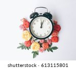 the noon clock with flowers on...   Shutterstock . vector #613115801