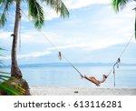 a girl is lying on a swing... | Shutterstock . vector #613116281