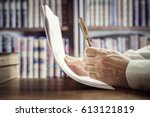 businessman reading documents... | Shutterstock . vector #613121819