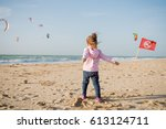 little girl playing with sand... | Shutterstock . vector #613124711