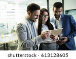 happy business colleagues... | Shutterstock . vector #613128605
