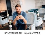 man waiting for woman in... | Shutterstock . vector #613129955