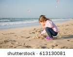 little girl playing with sand... | Shutterstock . vector #613130081