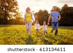 cheerful family together... | Shutterstock . vector #613134611