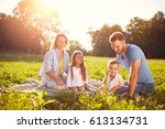 family with children on picnic... | Shutterstock . vector #613134731