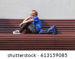tired schoolboy with glasses... | Shutterstock . vector #613159085