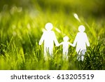 paper family on green grass | Shutterstock . vector #613205519