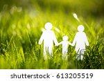 paper family on green grass | Shutterstock . vector #613205519
