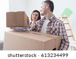 happy couple moving into a new... | Shutterstock . vector #613234499