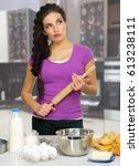 young cooking woman at kitchen | Shutterstock . vector #613238111