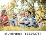 happy young friends having... | Shutterstock . vector #613243754