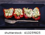 red peppers stuffed with cream... | Shutterstock . vector #613259825