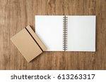 blank notepad on wooden... | Shutterstock . vector #613263317
