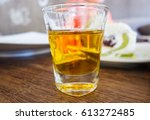 honey in a small glass with... | Shutterstock . vector #613272485