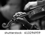 hand of a girl on violin... | Shutterstock . vector #613296959