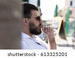 bearded man smoking. black and... | Shutterstock . vector #613325201