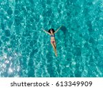 top view of young woman in a... | Shutterstock . vector #613349909