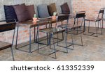 tables and chairs in a coffee... | Shutterstock . vector #613352339