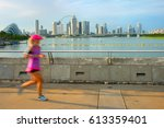 woman running at sunset in... | Shutterstock . vector #613359401