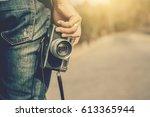 man photographer holding a... | Shutterstock . vector #613365944