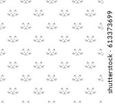 seamless pattern with cat faces ... | Shutterstock .eps vector #613373699