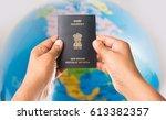 Man Holding Indian Passport...