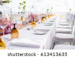 table setting at a luxury... | Shutterstock . vector #613413635