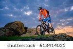 cyclist riding the mountain... | Shutterstock . vector #613414025