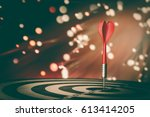 target hit in the center by... | Shutterstock . vector #613414205