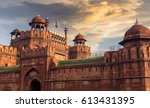red fort delhi at sunset with... | Shutterstock . vector #613431395