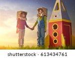 children in astronauts costumes ... | Shutterstock . vector #613434761