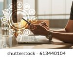 man use laptop and smartphon... | Shutterstock . vector #613440104