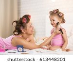 mom and daughter in the bedroom ... | Shutterstock . vector #613448201