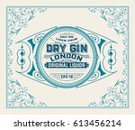 gin label with floral frame | Shutterstock .eps vector #613456214