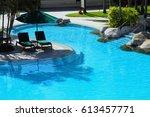 chair deck in hotel resort... | Shutterstock . vector #613457771