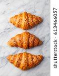 croissants on marble table.... | Shutterstock . vector #613466057