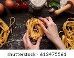 female hands making fresh... | Shutterstock . vector #613475561