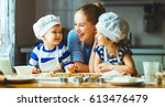 happy family in the kitchen.... | Shutterstock . vector #613476479