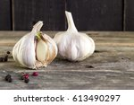 sprouted garlic with papper on... | Shutterstock . vector #613490297