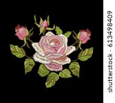 roses embroidery on black... | Shutterstock .eps vector #613498409