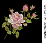 roses embroidery on black... | Shutterstock .eps vector #613498421